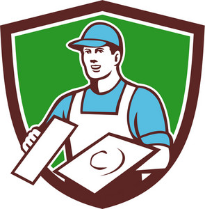 Illustration of a plasterer masonry tradesman construction worker wearing hat holding trowel viewed from front set inside shield crest done in retro style on isolated background.