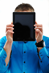 Image of a man covering his face with ipad