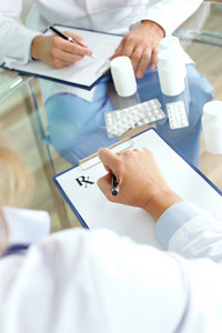 Image of practitioner prescribing tablets