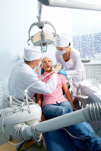 Image of  visit to stomatologist with dentistry equipments in front