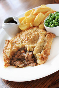 Traditional Beef Steak Pie With Chips And Peas