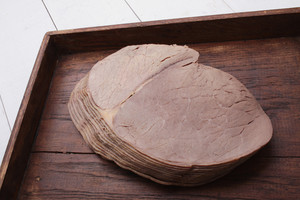 Sliced Roast Beef On Wooden Platter