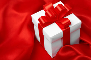 Gift on red satin background