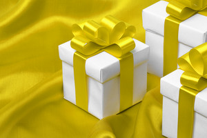 Gift on yellow satin background