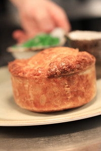 Steak And Mushroom Pie With Chips And Peas