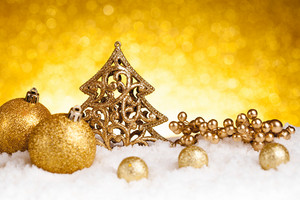 Golden christmas fir tree decoration with gold ornaments