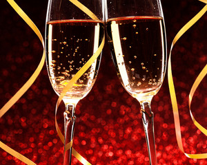 Glasses of champagne with yellow holidays ribbons
