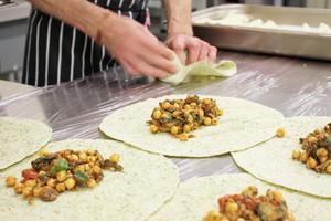 Chef Preparing Indian Chick Pea Wrap