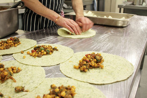Chef Preparing Indian Chick Pea Wrap