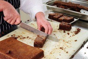 Pastry Chef Cutting Chocolate  Brownies