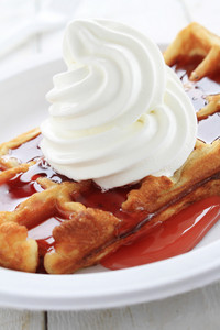 Traditional Waffle With Cream And Syrup