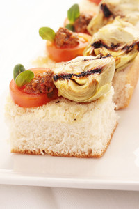 Artichoke And Tomato Bread Canape