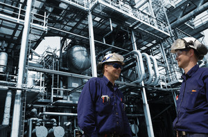 industrial workers inside refinery