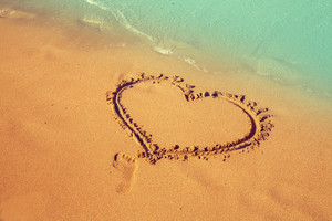 Inscription heart on beach sand