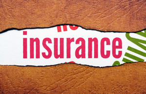 Insurance Text On Torn Paper