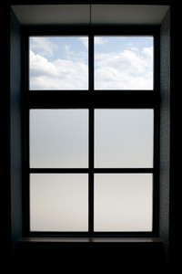 Interior view of a modern window that has frosted glass on the lower panes.