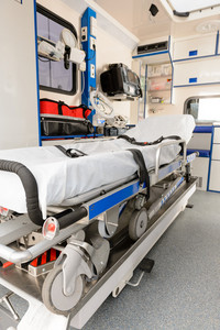 Interior view of an ambulance car with gurney in focus