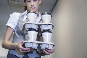 Intern carrying coffee