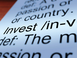 Invest Definition Closeup Showing Growing Wealth