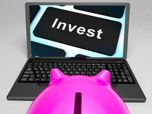 Invest Key On Laptop Showing Investment Market