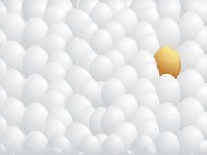 Isolated Golden Egg With White Egg Background