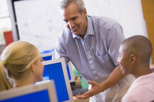 IT teacher demonstrating in class
