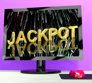 Jackpot Word With Fireworks On Computer Showing Winning