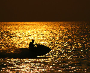Jet Ski On An Ocean At Sunset