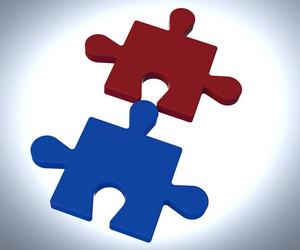 Jigsaw Pieces Shows Teamwork Concept