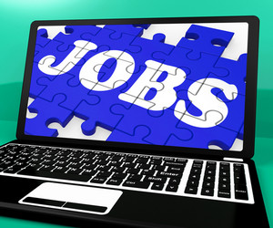 Jobs Puzzle On Notebook Shows Online Applications