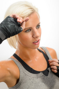 Kick-box woman sweating after tough workout isolated on white