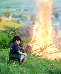 Kid beside the big fire