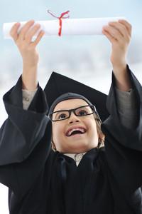 Kid celebrating diploma