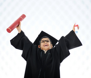 Kid celebrating graduating diploma