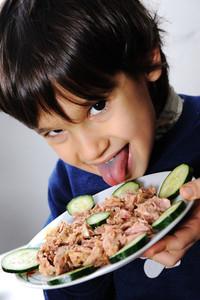 Kid eating fish