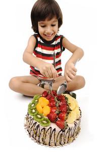 Kid eating fruit cake