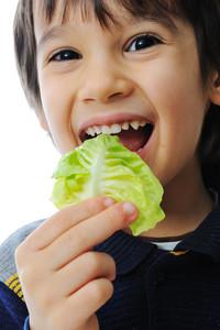 Kid eating salad