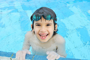 Kid having happy time in the pool water