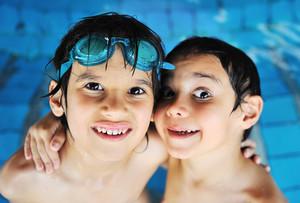 Kid having happy time in the pool water