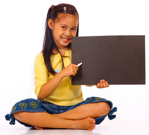 Kid Holding A Black Blank Board For Writing A Message
