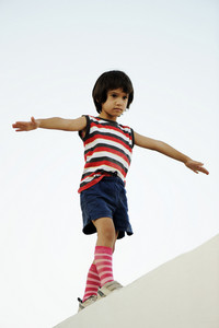 Kid holding balance walking on wall