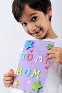 Kid holding message for Mom