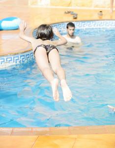 Kid jumping into swimming pool, great fun