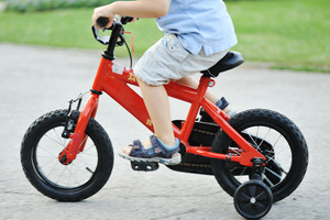 Kid  riding cycle