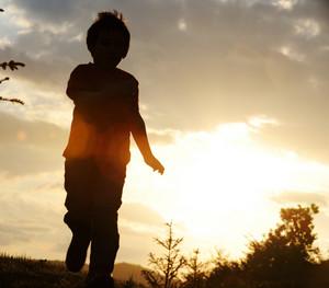 Kid running on field