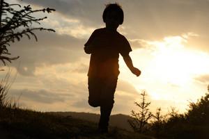 Kid running on meadow
