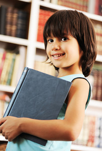 Kid with book in library