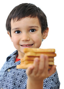 Kid with bread isolated