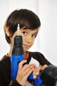 Kid with drill tool