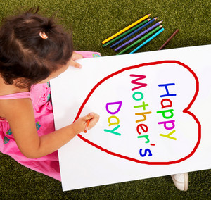 Kid Writing Happy Mother's Day Sign